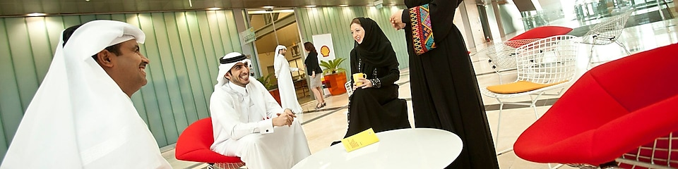 Qatari employees in casual meeting