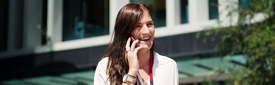 Shell Graduate Samantha Palmer holding the telephone