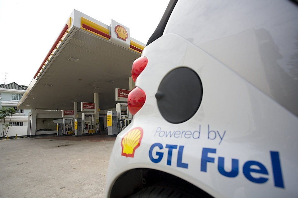 White car with GTL Fuel logo parked on a shell station