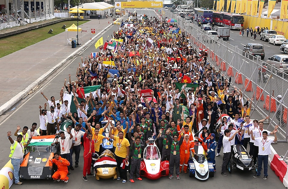 Participants pose with their vehicles during day one of the Shell Eco-marathon in Manila