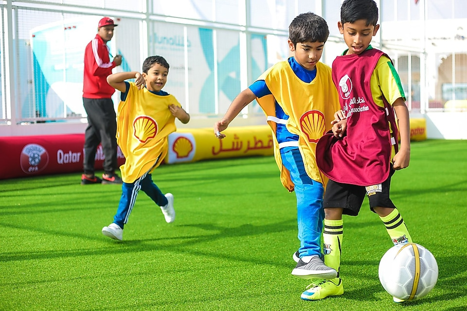 Kids playing football wearing shell clothes