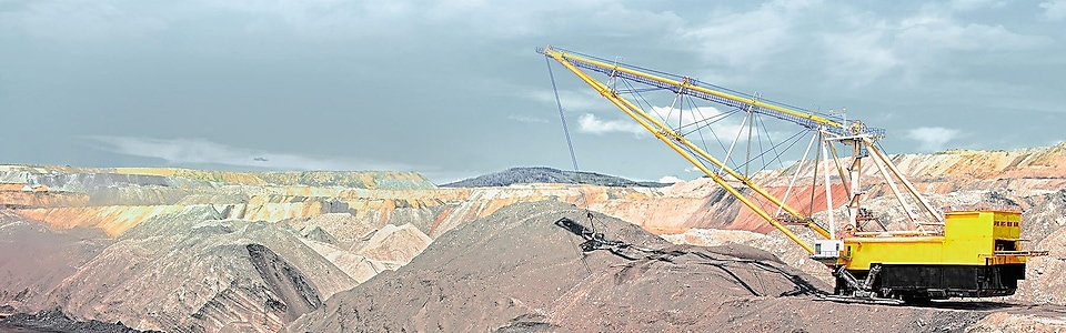 yellow crane liftingmachinery in a rock mine
